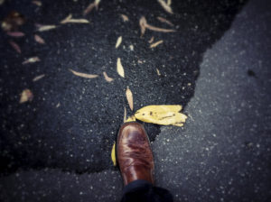 first person perspective of a shoe stepping on a banana peel