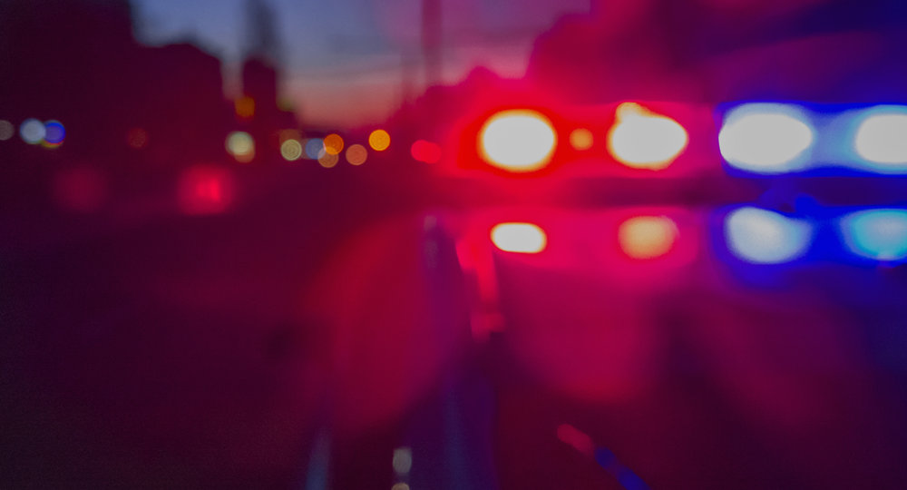 Red and blue Lights of police car in night time. abstract blurry image